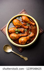 Chicken tangdi/tangri masala or leg curry served in a bowl. Selective focus