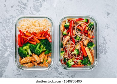 Chicken teriyaki stir fry meal prep lunch box containers with broccoli, carrots, rice or soba noodles