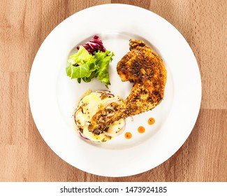 Chicken thigh with potato salad and lettuce