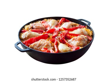 Chicken thighs and legs baked over a bed of rice and red bell pepper in cast iron stewpan. Isolated on white background with clipping path
