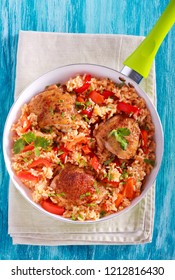 Chicken thighs rice and red pepper casserole in a pan