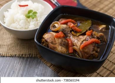 Chicken thighs in sauce Adobo. National filipino dish.
