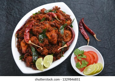 Chicken tikka kebab or chicken 65 hot and spicy dish garnished with curry leaves Kerala. a popular authentic roasted dish deep fried in coconut oil  South India. fried in a coating of Indian spices..