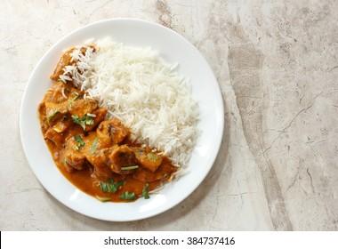 Chicken Tikka Masala with rice overhead view