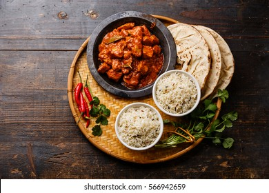 Chicken tikka masala spicy curry meat food Butter chicken with rice and naan bread on wooden background