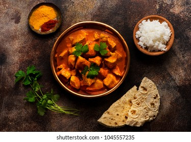 Chicken tikka masala spicy. Indian meat food in metal plate, rice and naan bread