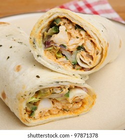 Chicken tikka wrap sandwich with yoghurt and mint dressing.