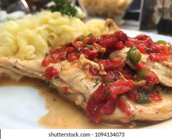 Chicken with Tomato and Red Pepper Sauce, with potatoes , Restaurant in Sofia, Bulgaria, May 2018