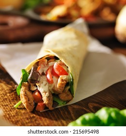 chicken with in tortilla with red peppers