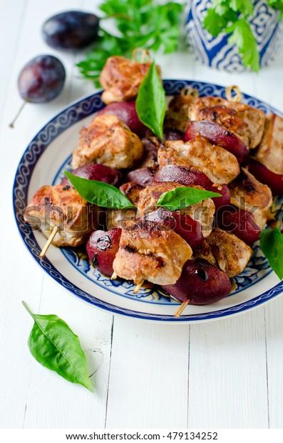 Chicken, turkey kebabs with plums