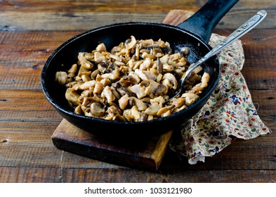 Chicken (turkey) and mushrooms fried with onions in a frying pan
