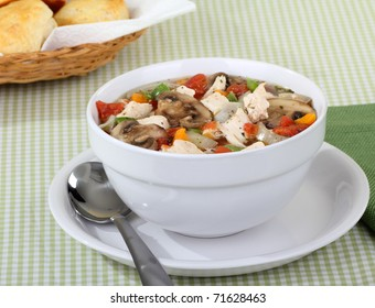 Chicken vegetable soup with mushrooms in a bowl