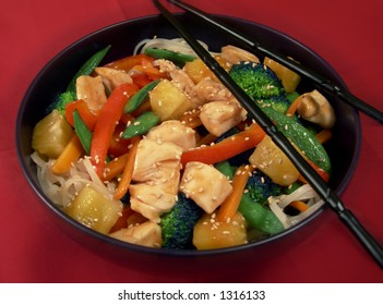 Chicken and vegetable stir fry over noodles.