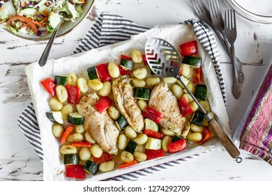 Chicken and vegetables in a white casserole dish