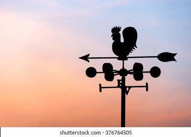 Chicken wind vane with compass and sky