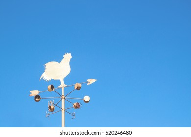 Chicken windmill with blue sky
