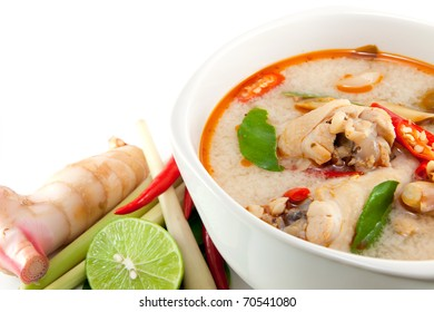 chicken wing tom yum in bowl (Thai food) and herb ingredient on white background
