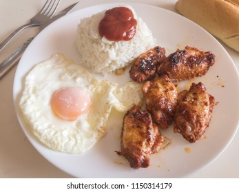 chicken wings barbecue with rice and fried egg