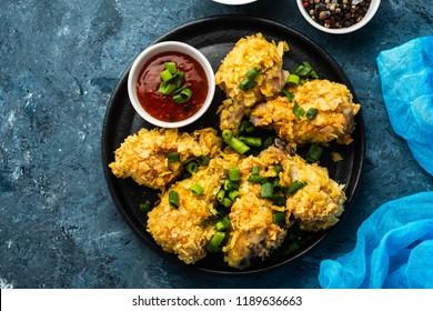Chicken wings in breading. Deep fried chicken wing. American food.