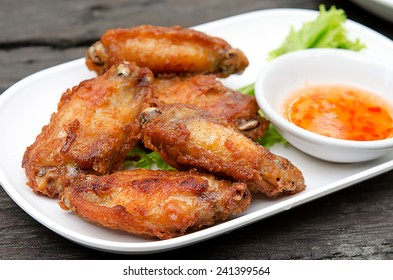 chicken wings on white dish wood background.