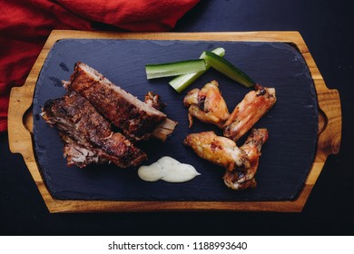 chicken wings and ribs dinner with dip
