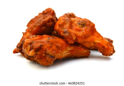 Chicken wings with sauce on white background