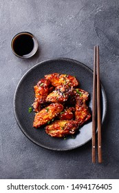 Chicken wings. Traditional asian recipe. Dark background. Copy space. Top view.