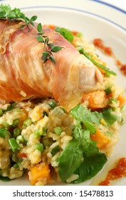 Chicken wrapped in prosciutto on pumpkin and rocket risotto.