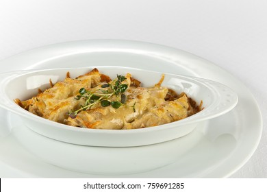 chicken,mashroom and cheese crepe casserole on white background