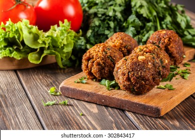 Chickpea falafel balls on a plate with vegetables