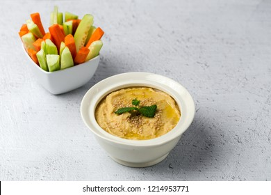Chickpea humus made at home. With paprika, cucumber and carrot. with light background