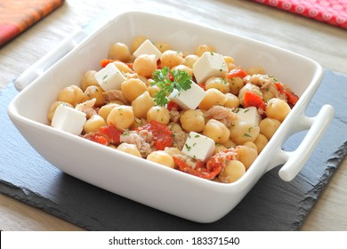 Chickpea salad with tuna, bell pepper, feta cheese and herbs