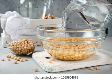 Chickpea soaked in water in a glass bowl. Ingredients for cooking