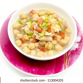 Chickpea stew with meat, pepper and tomato