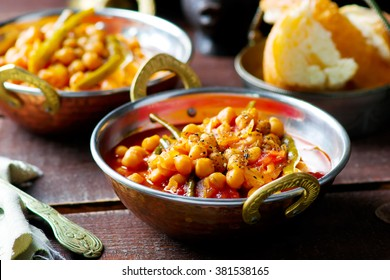 chick-pea stewed with haricot and a tomato on Lebanese in a copper vintage bowl. selective focus