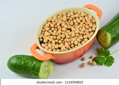 Chickpeas in a bowl on a white background