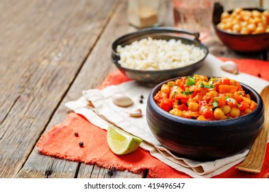 chickpeas carrots pepper coconut milk curry with brown rice. toning. selective focus