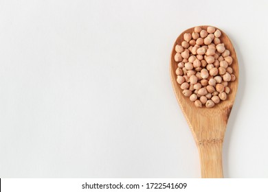 Chickpeas, chickpea beans in a wooden spoon, on a white background.