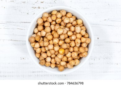 Chickpeas peas raw from above bowl wooden board wood