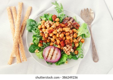 Chickpeas, tomato and rocket salad with bread sticks