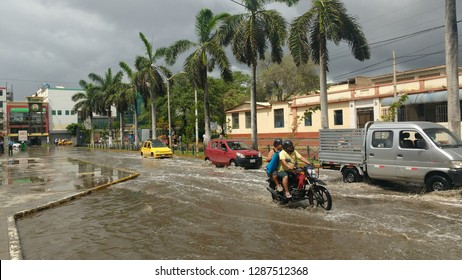 Chiclayo, Perú - 02 de febrero de 2017: vehicles pass with difficulty an avenue flooded by unforeseen rains as a result of climate change