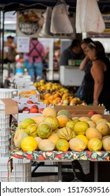 Chico, Ca / USA - 9/7/19: Crowd shopping at farmers market in california, fresh produce at local marketplace, late summer fruits, variety of melons, local produce
