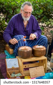Chico, Ca / USA - 9/7/19: older man playing steel drums at local farmers market, street musician playing drums for tips, live music, performance