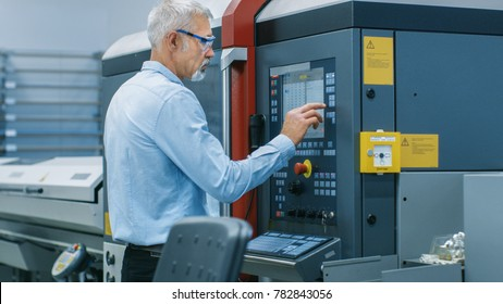 Chief Engineer/ Operator Programs/ Sets-up CNC Machine with Control Panel. He Works on the Modern Technologically Advanced Factory.