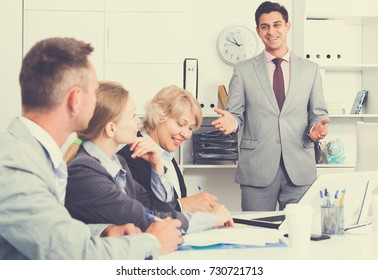 Chief gathering his managers for meeting at workplace