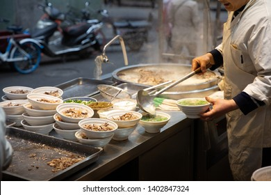 A chief at a halal restaurant making lamb offal soups by the street