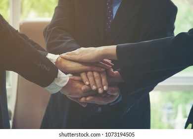 Chief handshake with staff.Sales team meeting introduces new employees in conference room, ethnic diversity of colleagues . Partnering Teams Together Direct Sales Business Conferencing Concepts