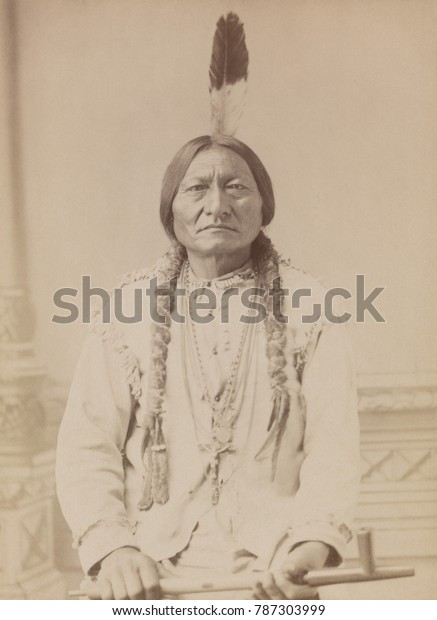 Chief Sitting Bull holding peace pipe in 1885 photo. When signing on with BUFFALO BILLS WILD WEST show, Sitting Bull negotiated exclusive rights over the sale of photographs of himself