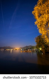 Chiemsee at night with illuminated tree and stars