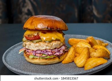 chiken hamburger on grill. Smoke,